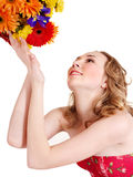 Young woman holding flowers. Royalty Free Stock Photography