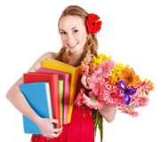 Young woman holding flowers and books. Royalty Free Stock Photos