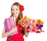 Young woman holding flowers and books. Royalty Free Stock Photography