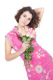 Young woman holding flowers in her hands Stock Photography