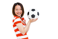 Young woman holding football Stock Image