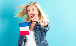Young woman holding French flag Royalty Free Stock Images
