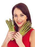 Young Woman Holding Fresh Asparagus Royalty Free Stock Images