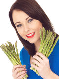 Young Woman Holding Fresh Asparagus Stock Images