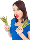 Young Woman Holding Fresh Asparagus Royalty Free Stock Photo