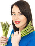 Young Woman Holding Fresh Asparagus Royalty Free Stock Photos