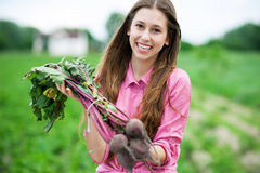 Young woman holding fresh beets Stock Image