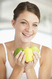 Young Woman Holding Fresh Fruit Stock Photography