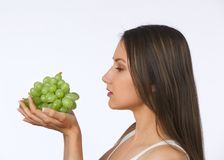 Young woman holding fresh grapes Royalty Free Stock Photography
