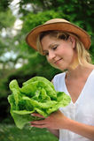 Young woman holding fresh lettuce Royalty Free Stock Photos