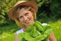 Young woman holding fresh lettuce Royalty Free Stock Images