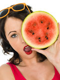 Young Woman Holding a Fresh Ripe Juicy Watermelon Stock Image