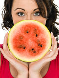 Young Woman Holding a Fresh Ripe Juicy Watermelon Stock Photos