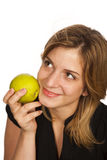 Young woman holding  fruit. Young woman holding green apple over white background Royalty Free Stock Photo