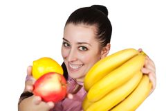 Young woman holding fruit Royalty Free Stock Photography