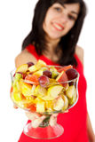Have some Fruits. Young woman holding a fruit salad - focus on salad Royalty Free Stock Photography