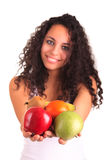 Young woman holding fruits. Isolated over white Royalty Free Stock Images