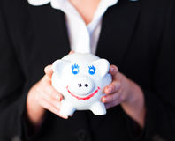 Young woman holding a funky piggy bank Royalty Free Stock Images