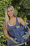 Young Woman Holding Gardening Toolkit Royalty Free Stock Photo