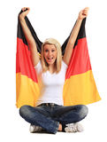 Young woman holding german flag. Full length shot of an attractive young woman holding german flag. All on white background Royalty Free Stock Photography