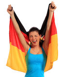 Young woman holding german flag Royalty Free Stock Photo