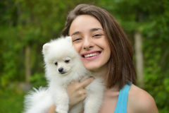 Young woman holding german spitz puppy Stock Photography