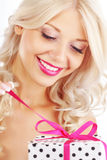 Young woman holding gift Royalty Free Stock Image
