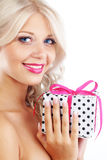 Young woman holding gift Stock Photo