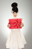Young  woman holding gift Royalty Free Stock Photography