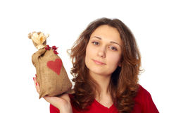 Young Woman holding a gift bag Royalty Free Stock Photo