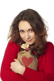 Young Woman holding a gift bag Royalty Free Stock Image