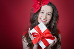 Young woman holding Gift box Royalty Free Stock Images