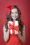 Young woman holding Gift box Royalty Free Stock Photos