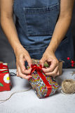Young woman holding gift box. Christmas days, preparing the decoration Stock Image