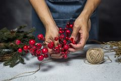 Young woman holding gift box. Christmas days, preparing the decoration Royalty Free Stock Images