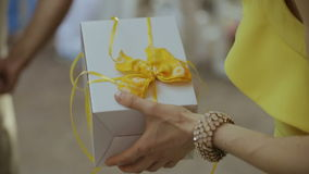 Young woman holding gift box in her hand stock video footage