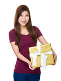 Young woman holding gift box Stock Image