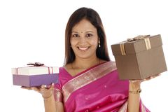 Young  woman holding gift boxes Royalty Free Stock Images