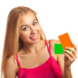 Young woman holding gift cards Stock Photos