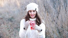 Young woman holding a gift in her hands stock footage