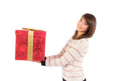 Young woman holding a gift while smiling at camera Royalty Free Stock Photography