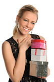 Young Woman Holding Gifts Royalty Free Stock Photography