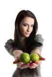 Young woman holding and giving away limes Stock Image