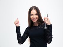 Young woman holding glass with champagne Stock Photos