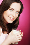 Young woman holding a glass of fresh milk Stock Photo