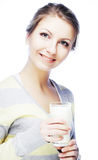young woman holding a glass of fresh milk Stock Photography