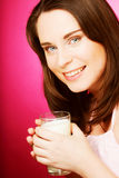 young woman holding a glass of fresh milk Stock Images