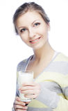 young woman holding a glass of fresh milk Stock Photos