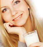 Young woman holding a glass of fresh milk Royalty Free Stock Image