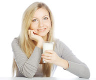young woman holding a glass of fresh milk Royalty Free Stock Photography
